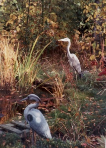 Pretend and real Heron stake out the pond